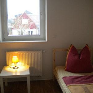 Schlafzimmer Ferienwohnung rechtes Bett